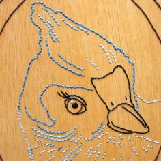 An unique embroidery on wood