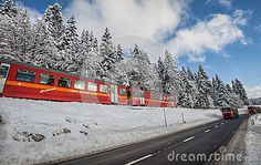 La Givrine, St Cergue, Switzerland.The Nyon-St Cergue-La Cure electric train travelling through he snow in Switzerland.Picture was captured on November 30th, 2012.