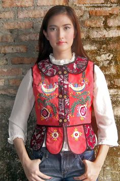 http://batikamarillis-shop.com Batik Amarillis made in Indonesia  batik amarillis's piccola vest  features hungarian embroidery inspired meets tenun batik  gedog Tuban,Indonesia. Take a fresh, sweet & whimsical approach to power dressing with this Krakow-Poland classic traditional folklore inspired jacket.  The beauty essential is reworked with a contrast-coloured batiks,unique cuttings ,trims,glossy beaded buttons,it has fitted waist with unique peplum petals