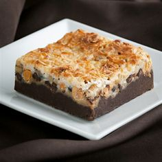 Try our new Seven Layer brownie! A chocolate fudge brownie layered with graham crackers, semi sweet chips, butterscotch chips, chopped walnuts, and shredded coconut. Order one or two now at browniepointsinc.com