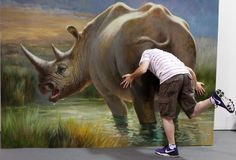 People interact with 3D paintings at the Magic Art exhibition in China.