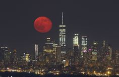 The moon rises above lower Manhattan and One World Trade Center in New York City on June 10, 2017, as seen from West Orange, New Jersey.