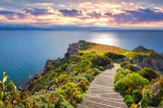 Descending towards the tip of Capo Milazzo at sunset