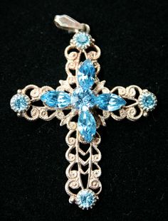 Silver Cross with blue Aquamarine coloured stones.  Tests as silver with Troy Test Acid. Measures 1 3/4 inches tall by 1 1/2 inches wide.  A fantastic item. Great as a gift  Please Quote BAW 13-04 our price £35    Please repin   To buy this item go to www.Browse-a-whil...