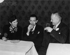 Young Salvador Dalí drinking Champagne with his wife Gala Dalí and Jacques Bollinger