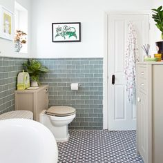 Traditional white bathroom with green metro tiles