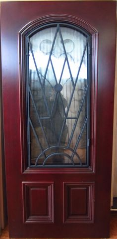 2/3 ARCH TOP IRON GRILL MAHOGANY WOOD DOOR | Knotty Alder | Doors for Builders, Inc. | Solid Wood Entry Doors | Exterior Wood Doors | Front Doors | Entry Doors | Mahogany Wood Doors | Mahogany Entry Doors | Home Builders | Home Improvement | Home Remodeling |
