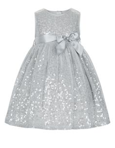 Our dazzling Evalina tulle party dress for baby girls is decorated with all-over sparkling sequins, and finished with a satin sash and bow on the waist. This stand-out style is fully lined for comfort, and features back button fastenings.