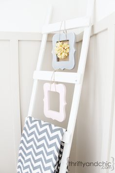 DIY Decorative Ladder    2 1x2s, measured at the same length {6.5 feet long}  5 1x4s, measured at the same length {16 inches} http://www.thriftyandchic.com/2013/02/decorative-ladder-tutorial.html
