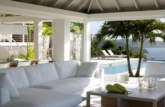 Tropical Living Room loving the white and cool fabrics