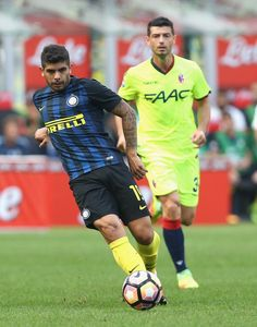 Ever Banega Photos Photos - Ever Banega (L) of Inter during the Serie A match between FC Internazionale and Bologna FC at Stadio Giuseppe Meazza on September 25, 2016 in Milan, Italy. - FC Internazionale v Bologna FC - Serie A