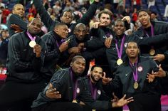 Members of the U.S. men's basketball team strike a pose after winning gold in the championship game against Spain.