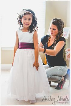 Traditional Wedding Details- Flower girl getting ready with purple sash
