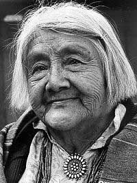 Lucy Lewis learned to make pottery by watching other Acoma women, through observation and experimentation, rather than formal art training. Her work was first influenced by the sacred pots she saw in the kivas, which had traditional Acoma designs--parrots, flowers, and rainbows. Early in her career, Lewis, like many other Acoma women, frequently sold works to tourists along the highway