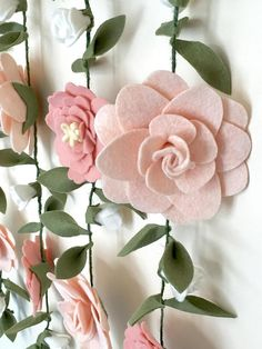 Vertical floral garland wall hangings are a touch of enchantment to a girls room focal wall or as floral Birthday photo backdrop! The second photo shows how a floral wall creates the perfect backdrop for photo shoots that give your treasured moment a love Felt Flowers, Diy Flowers, Fabric Flowers, Paper Flowers, Felt Diy, Felt Crafts, Diy And Crafts, Floral Garland, Flower Garlands