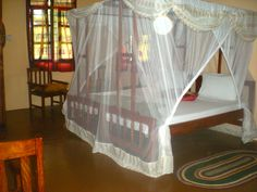 Mosquito nets and colorful kangas as curtains in each spacious room @ Mangrove Lodge, Zanzibar, Tanzania