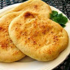 Indian Naan II cup warm water degrees degrees C) 1 teaspoon active dry yeast 1 teaspoon white sugar 2 cups all-purpose flour 1 teaspoon salt cup ghee 2 tablespoons plain yogurt 2 teaspoons kalonji (onion seed) Bread Recipes, Cooking Recipes, Naan Recipe, Indian Food Recipes, Ethnic Recipes, Love Food, The Best, Food And Drink, Yummy Food
