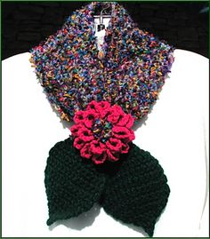 The Dahlia Keyhole Scarf works up quickly crocheted from bulky yarn. You can easily make one in a day, so they are great as last minute gift ideas. The dahlia embellishment is made with sport or DK weight yarn, and adds a lot of interest to the scarf. Fun to make and warm to wear, there are two versions. Make either version with your favorite bulky yarn, or with the yarns I used for the design.