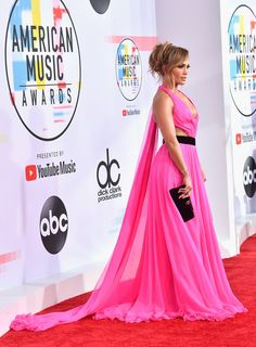 Jennifer Lopez at AMAs 2018 Wearing Chakra couture gown with Jimmy Choo shoes . Jennifer Lopez at AMAs 2018 Wearing Chakra couture gown with Jimmy Choo shoes . Jennifer Lopez 2017, Valentines Day Weddings, Glamorous Dresses, Poses For Photos, Dramatic Look, American Music Awards, Festival Wedding, Red Carpet Dresses, Popsugar