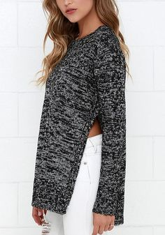 What's a fab way to beat the cold? It's donning this black mélange side-slit knit sweater.