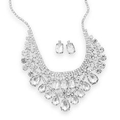 """16"""" + 3"""" extension silver tone fashion necklace with multishape clear crystals. Multiple rows of round, rectangle and pear shape clear crystals range in size from 12mm x 18mm down to 2.5mm. This neckl"""