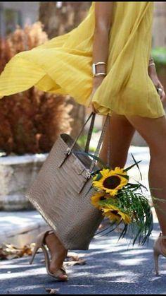 Yellow dress and sunflowers