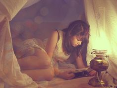 Reading by lamp light.