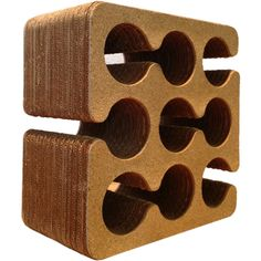 Frank Gehry cork and corrugated cardboard wine rack  USA  1980s  Frank Gehry cork and corrugated cardboard wine rack, with nine-bottle capacity.