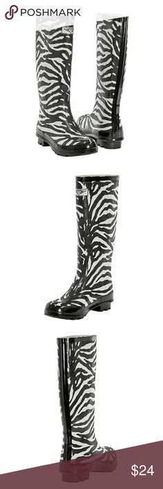 """Women Knee High Rainboots, #1401, Zebra Brand new glossy woman tall rainboots by Forever Young. Striking zebra pattern, cotton lining, removable sole. Posh buckle on the calf side. Approx 14"""" tall & approx 15"""" in circumference. 100% rubber rain boot!!!Taller than galoshes and protect your feet better while you garden or just walk in the fall or winter rain. Not made for wide calves. Run half a size larger than regular shoes. A true statement in ladies fashion! Please no offers, the price is…"""