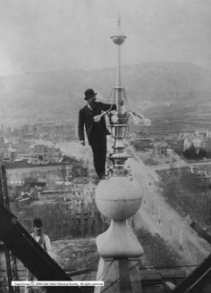 1892 - E. G. Holding inspecting an electric light on top of the Salt Lake Temple - in a suit, tie, and hat no less!