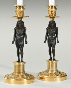 A PAIR OF NEOCLASSICAL GILT AND PATINATED BRONZE CANDLESTICKS MID-19TH CENTURY.