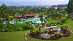 Hotel pool with Bukit Barisan mountain view, Brastagi, Indonesia.