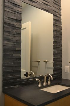 The 3x6 Bianco Venatino marble on the walls features Architectural