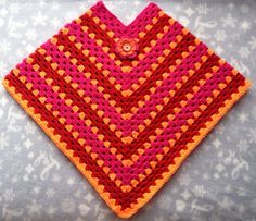 Crochet poncho made with happy colors