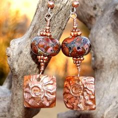 Copper Ammonites (from #KristiBowmanDesigns) and Chocolate Lampwork Handmade Earrings by #ShadowDogDesigns  http://www.artfire.com/ext/shop/product_view/ShadowDogDesigns/4362918