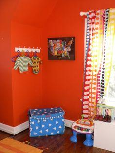 Unisex Nursery, Primary colors lots of orange and white. , Nurseries Design