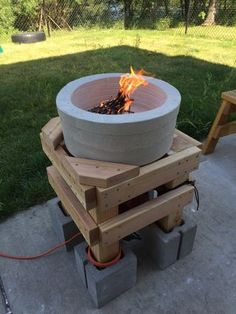 Make your own forge with these instructions.  http://www.homesteadingfreedom.com/how-to-build-a-forge-for-the-homestead/