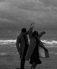 Couple dancing on beach beach / luxury / rich