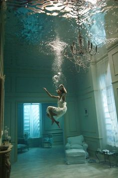 This reminds me of poseidon or the titanic. I picture water flooding beautiful rooms like this and seeing people in the water. I like the idea of the person appearing to be jumping into the water. Well done and great colors.