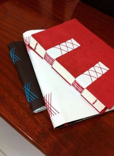 Romanesca e codex from Papeliê Brasil - love the contrast of red and white on these long stitch journals