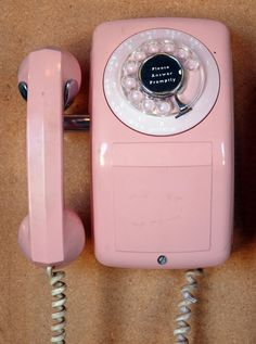 Pink wall mounted telephone