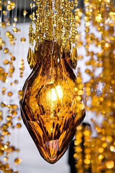 Flash by @lukacka for Sans Souci - a solitary pendant looking impressive on a curtain of cut beads. A modern light fixture of regal jewel that is the masterpiece of a hand cutter. The combination of glittering crystal and golden amber gives rise to a flaming swarm, which will imbue your place with sparkling energy.