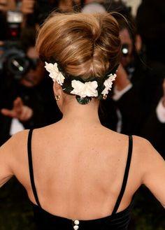 Flowers along bottom of hair do!