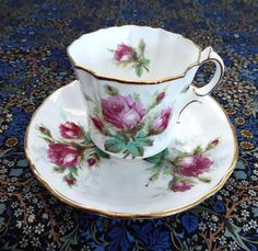 This is a very pretty English bone china cup and saucer in the Grandmother's Rose pattern with pink Moss Roses and gold trim by Hammersley, England made in the 1970s and is a variation of one of the o