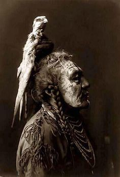 Two Whistles, a Crow Man, by Edward S. Curtis, 1908