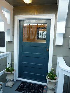 Blue door with darker grey and white trim.