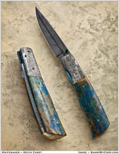Feather Damascus liner lock folder with meteorite bolsters