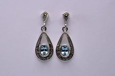 Earrings silver marcasite with aquamarine €25