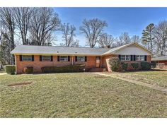 AMAZING fully renovated brick ranch in a quiet neighborhood, on a HUGE lot in Charlotte. Refinished hardwood floors flow throughout the open. Charlotte North Carolina, Charlotte Nc, Local Listings, Refinishing Hardwood Floors, Brick Ranch, Home Values, Shed, Real Estate, Outdoor Structures