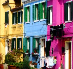 """There's a Rainbow-Colored Island Hiding in Northern Italy/ Rainbow-colored houses are actually not the only reason Burano is a famed locale. Often referred to as """"Lace Island,"""" Burano has a long history of traditional, Italian lacemaking; the practice dates back to the 16th century. Today, craftspeople still sell their products in little shops around Galuppi Square, the island's main plaza."""
